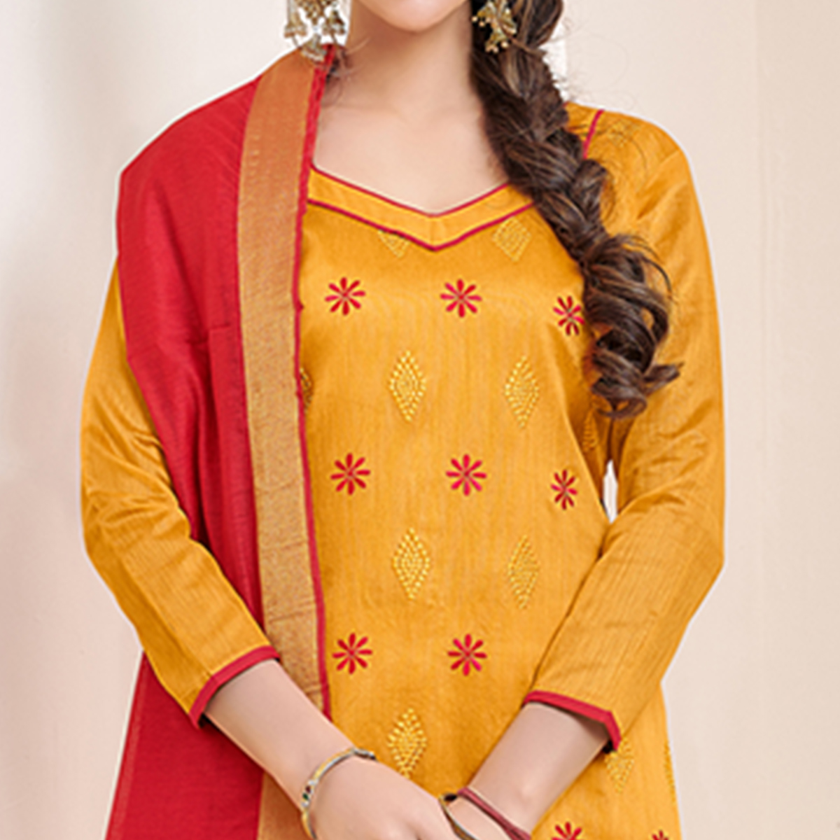 Stunning Orange Colored Partywear Embroidered Cotton Dress Material