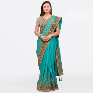 Intricate Teal Colored Party Wear Embroidered Raw Silk Saree