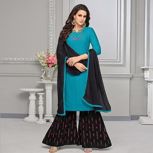 Appealing Sky Blue Colored Partywear Embroidered Rayon Palazzo Suit