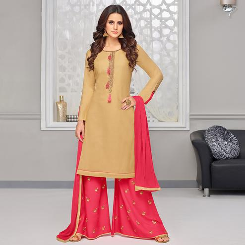 Beautiful Beige Colored Partywear Embroidered Rayon Palazzo Suit