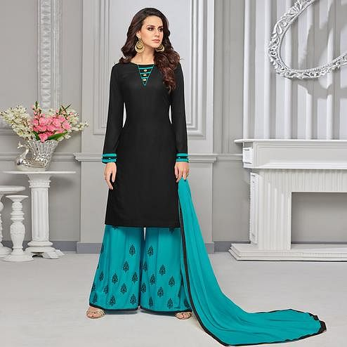 Stunning Black Colored Partywear Embroidered Rayon Palazzo Suit