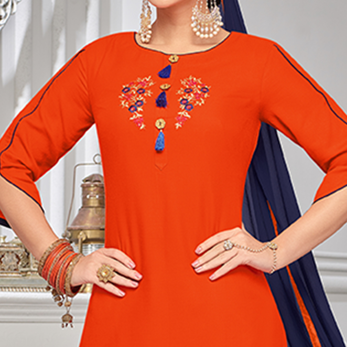 Blooming Orange Colored Partywear Embroidered Rayon Palazzo Suit