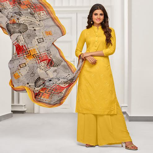 Blooming Yellow Colored Partywear Embroidered Cotton Suit