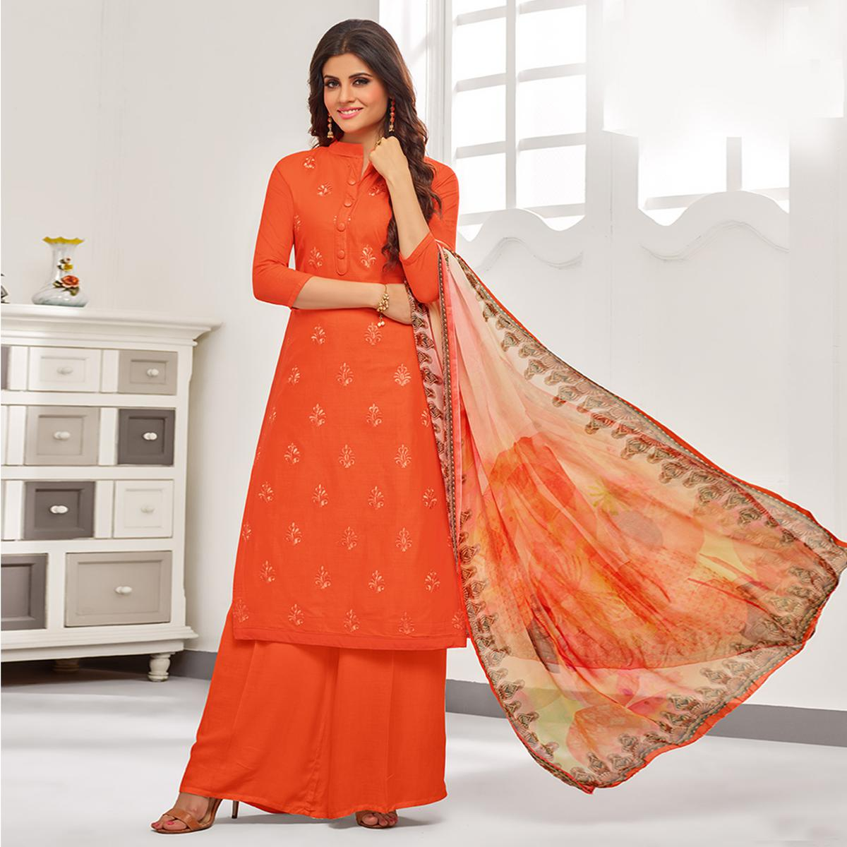 Magnetic Orange Colored Partywear Embroidered Cotton Suit