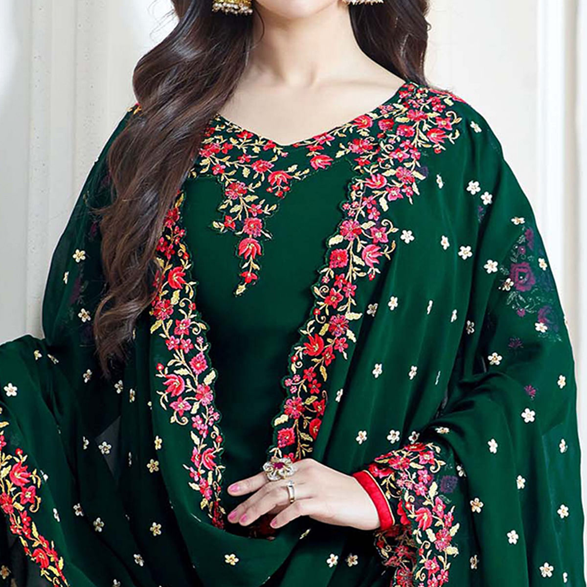 Eye-Catching Dark Green Colored Partywear Embroidered Georgette Suit