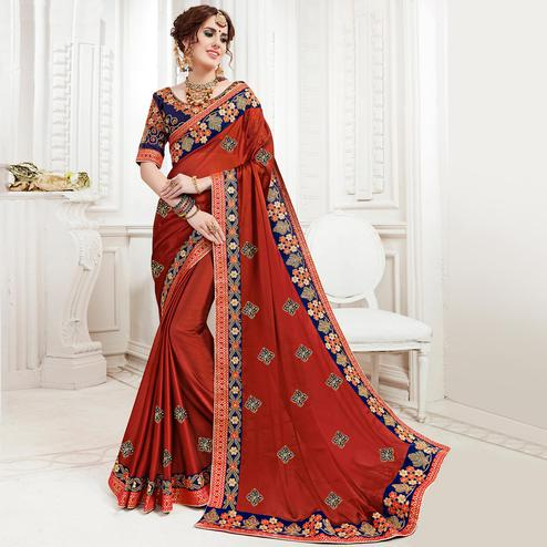 Unique Rust Orange Colored Partywear Embroidered Georgette Saree
