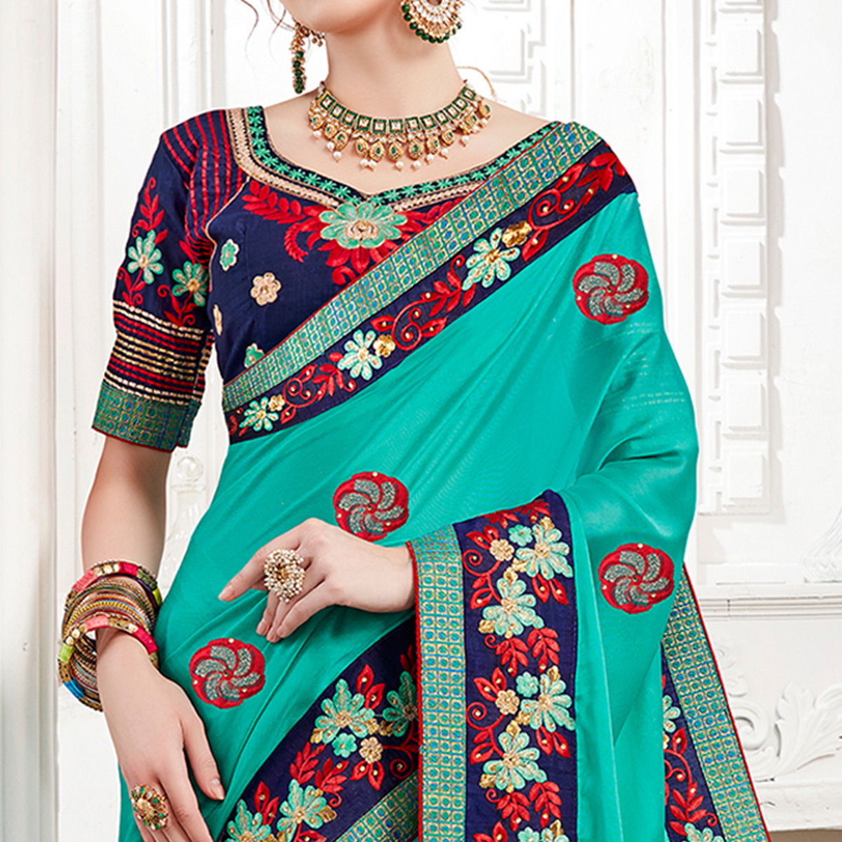 Desiring Aqua Green Colored Partywear Embroidered Georgette Saree