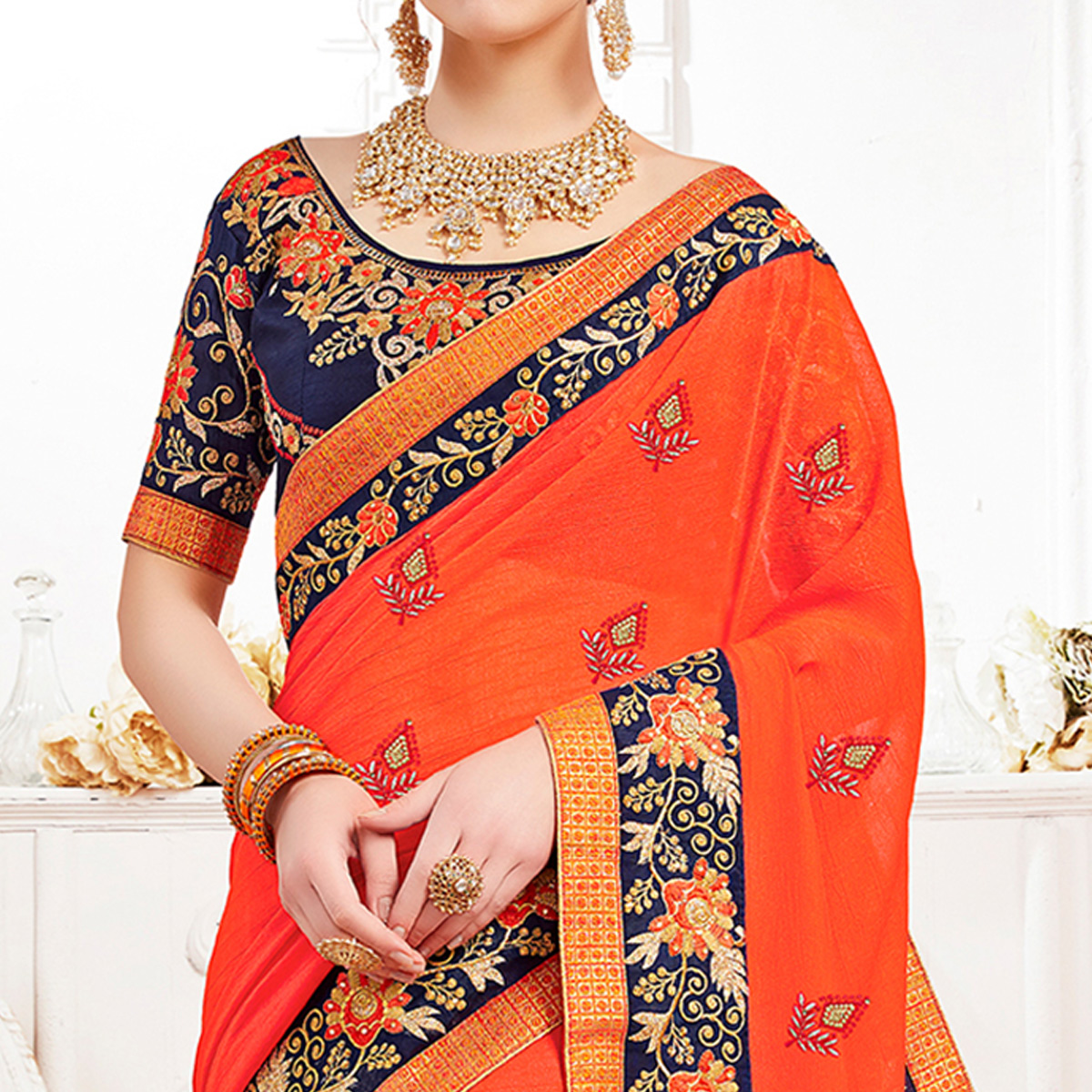 Glowing Orange Colored Partywear Embroidered Georgette Saree