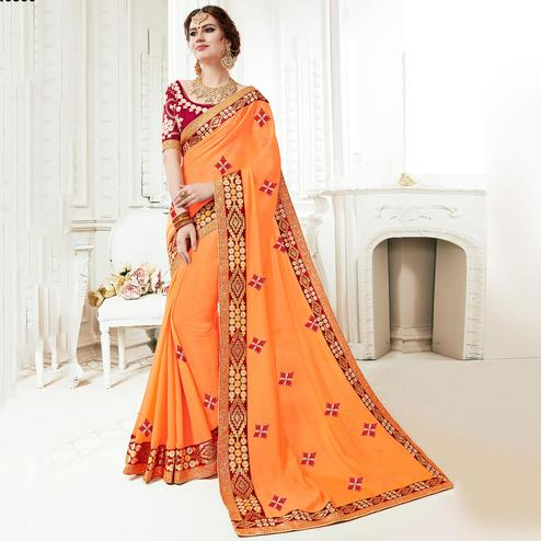 Appealing Light Orange Colored Partywear Embroidered Georgette Saree