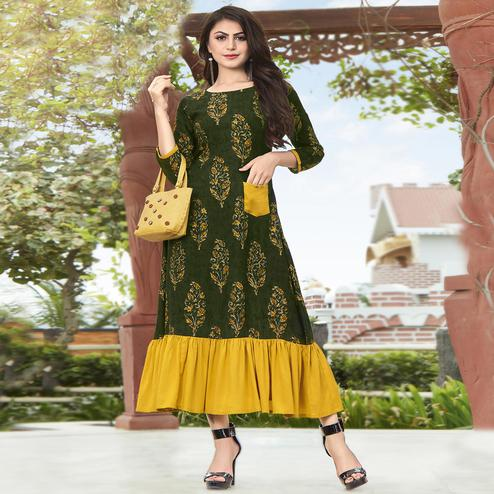 Refreshing Dark Green Colored Partywear Printed Rayon Kurti