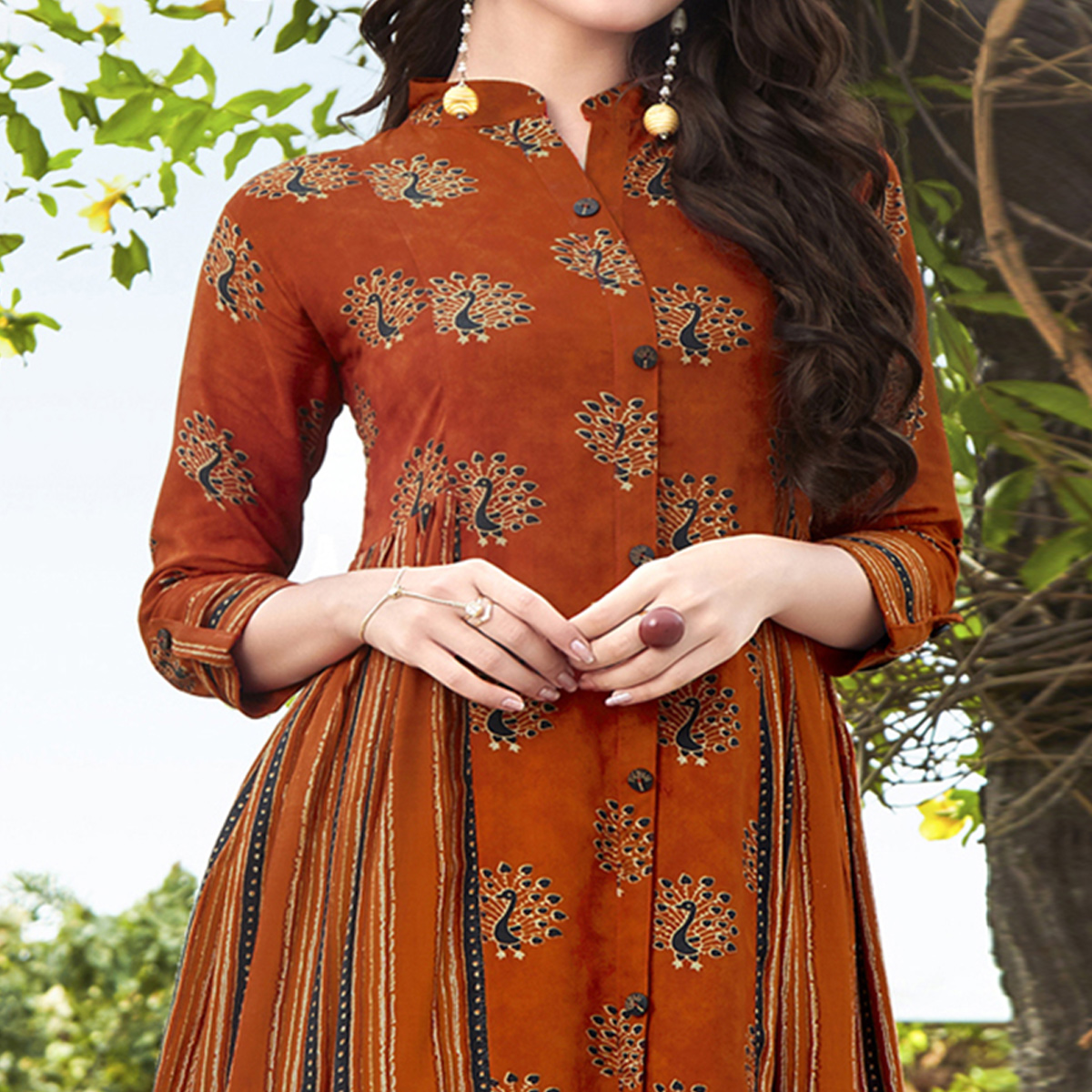 Attractive Rust Orange Colored Partywear Printed Rayon Kurti