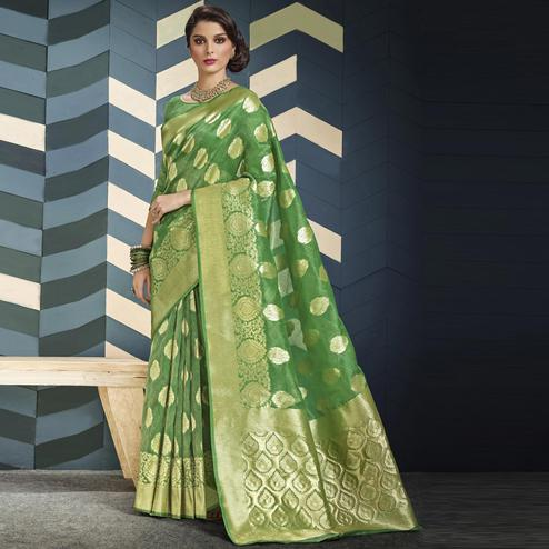 Impressive Green Colored Festive Wear Woven Organza Silk Saree