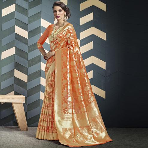 Engrossing Orange Colored Festive Wear Woven Organza Silk Saree