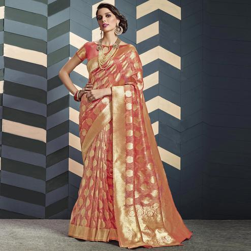 Staring Peach Colored Festive Wear Woven Organza Silk Saree