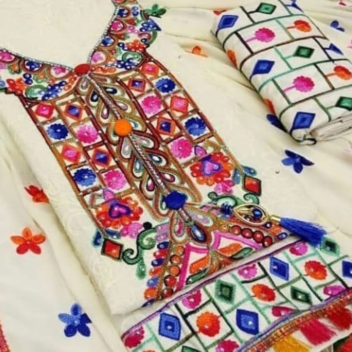 Appealing Off-White Colored Partywear Embroidered Cotton Dress Material