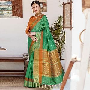 Arresting Green Colored Wedding Wear Woven Cotton Silk Saree