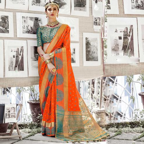 Surpassing Orange Colored Wedding Wear Woven Cotton Silk Saree