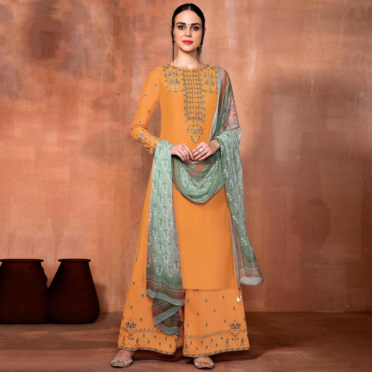 Entrancing Light Orange Colored Party Wear Embroidered Muslin Silk Suit