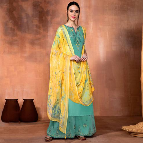 Imposing Teal Blue Colored Party Wear Embroidered Muslin Silk Suit