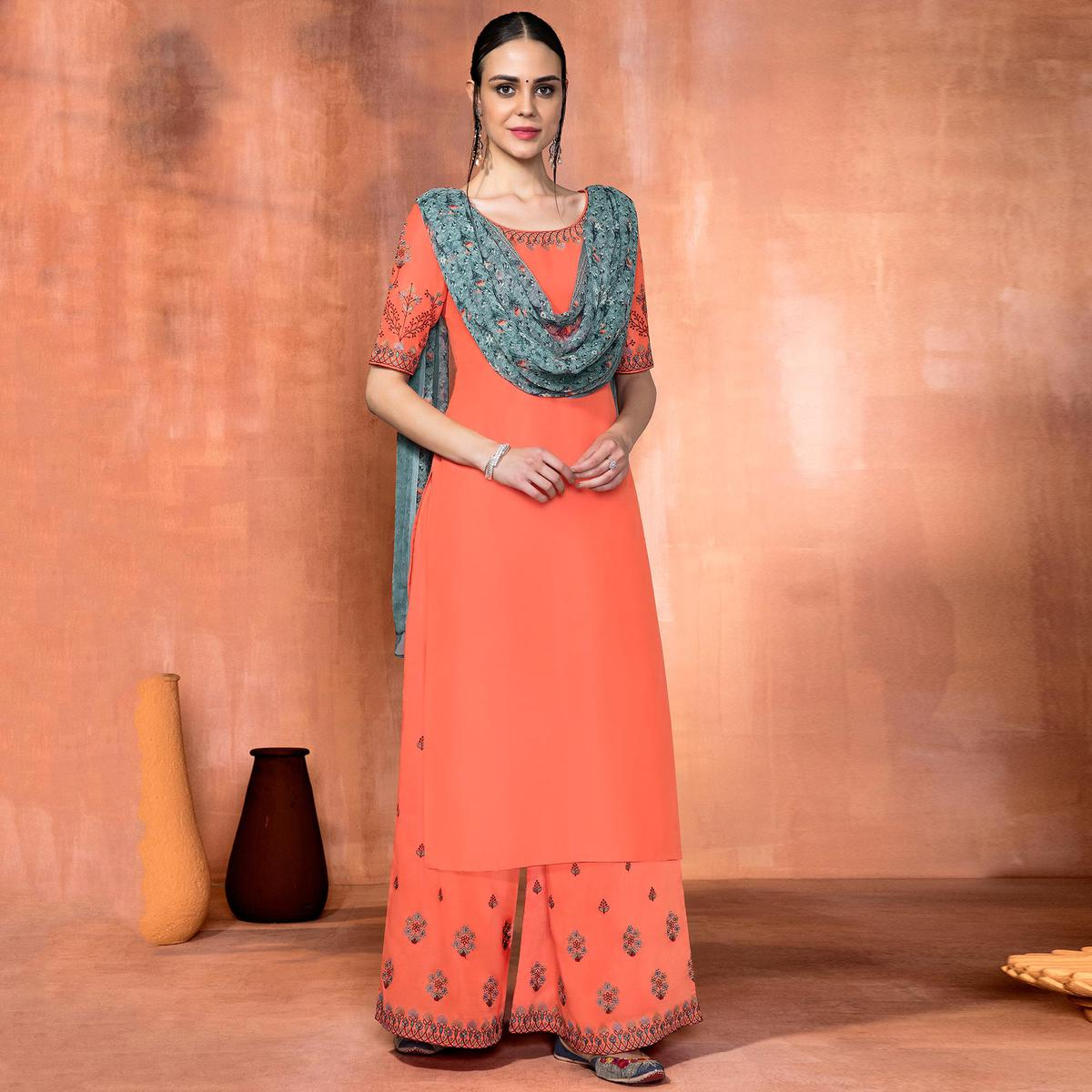Elegant Peach Colored Party Wear Embroidered Muslin Silk Suit