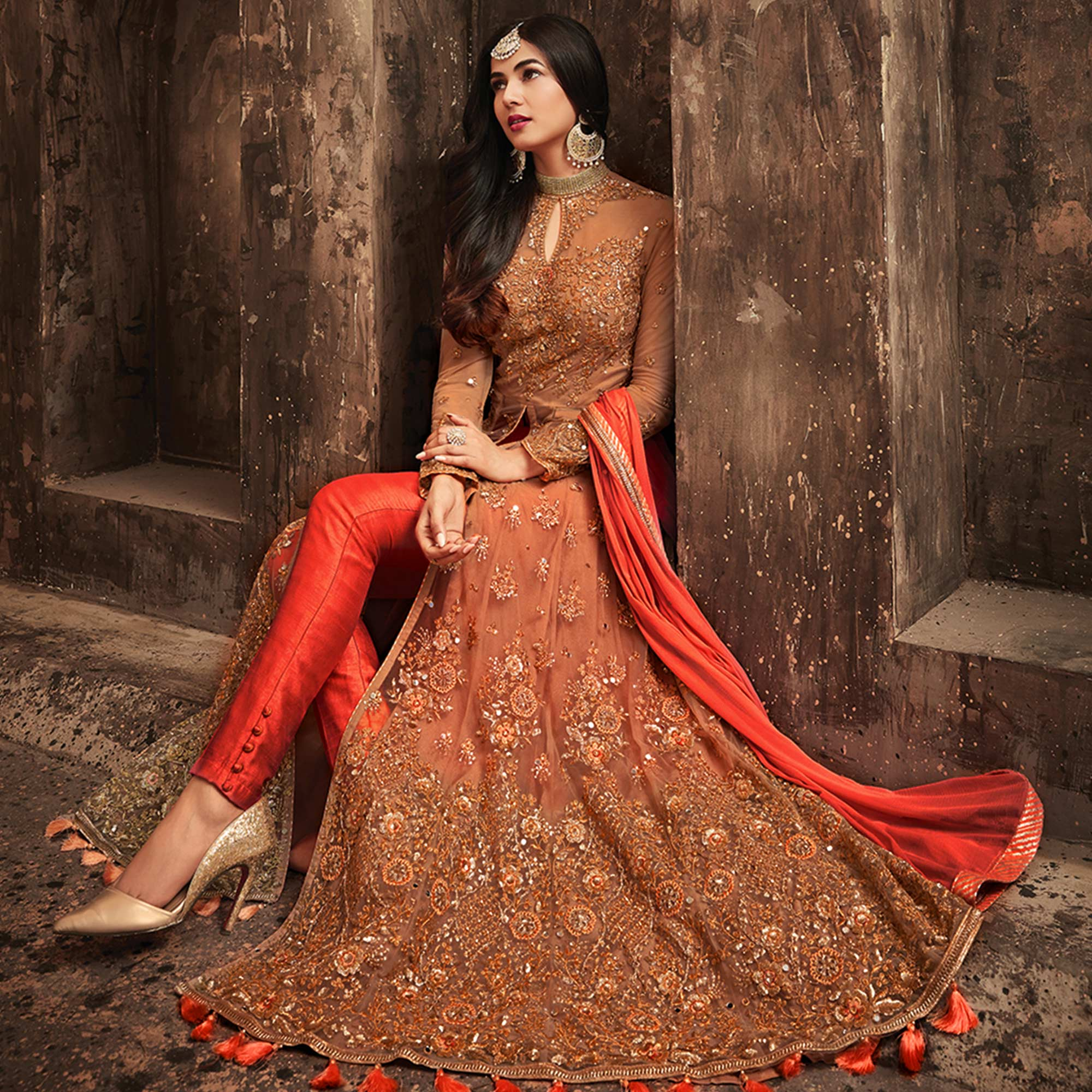 Arresting Red Colored Partywear Embroidered Netted Lehenga Kameez