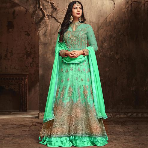 Refreshing Aqua Green Colored Partywear Embroidered Netted Lehenga Kameez