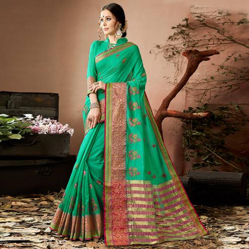Adorning Turquoise Green Colored Partywear Embroidered Cotton Silk Saree