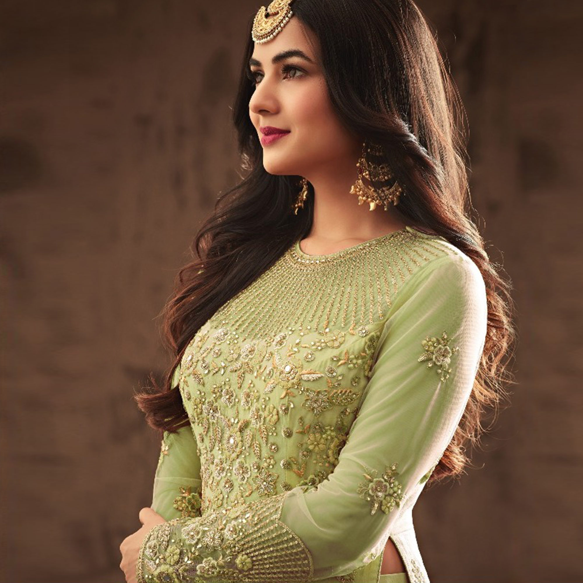 Gleaming Light Green Colored Partywear Embroidered Netted Lehenga Kameez