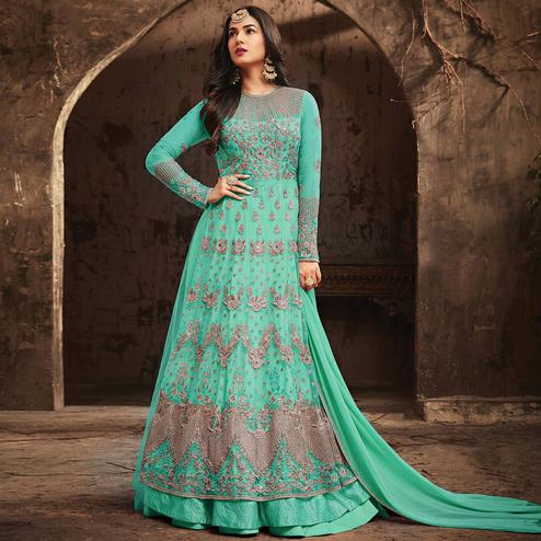 Gorgeous Aqua Blue Colored Partywear Embroidered Netted Anarkali Suit
