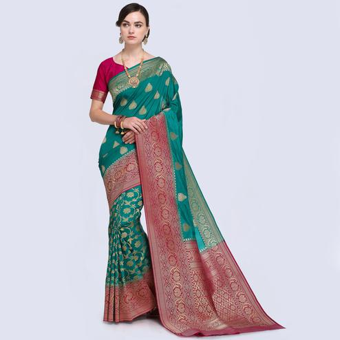Deserving Rama Green Colored Festive Wear Woven Silk Saree