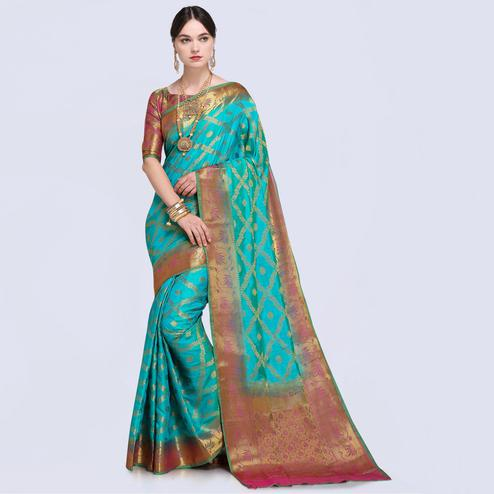 Exceptional Bright Turquoise Colored Festive Wear Silk Saree