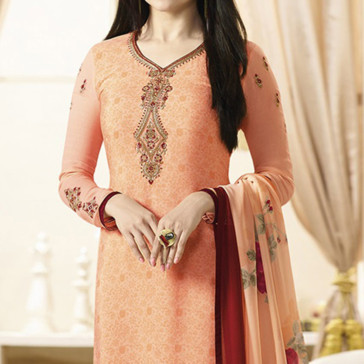 Attractive Light Orange Designer Embroidered Silk Salwar Suit