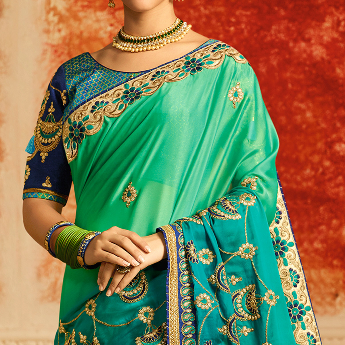 Gleaming Aqua Green Colored Partywear Embroidered Silk Saree