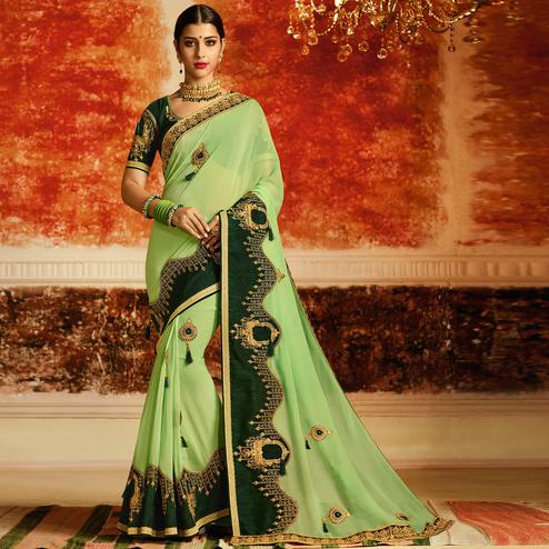 Beautiful Pista Green Colored Partywear Embroidered Georgette Saree