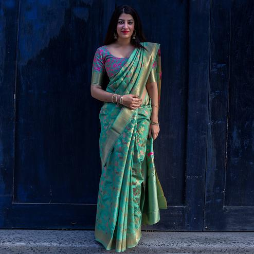 Intricate Turquoise Colored Festive Wear Banarasi Silk Saree