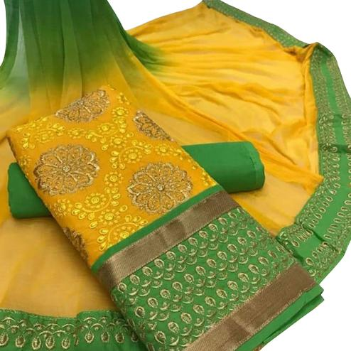 Pleasant Yellow Colored Party Wear Embroidered Cotton Dress Material