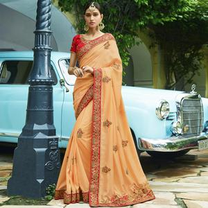 Stunning Light Orange Colored Party Wear Embroidered Silk Saree