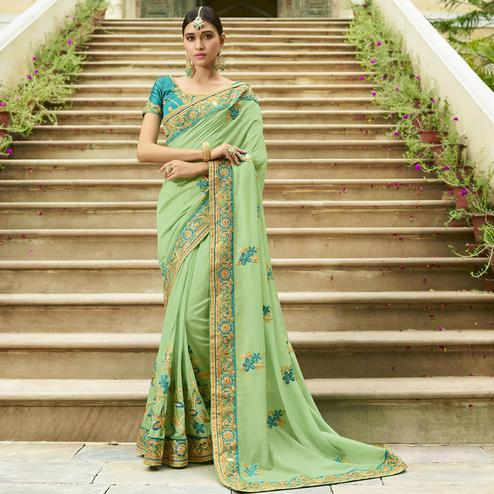 Dazzling Pale Green Colored Party Wear Embroidered Silk Saree