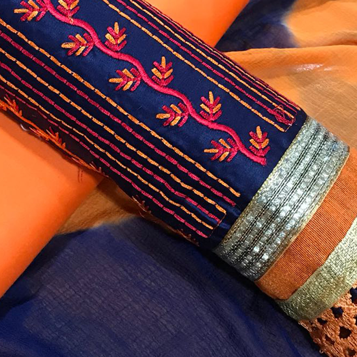 Mesmeric Blue-Orange Colored Partywear Embroidered Cotton Dress Material