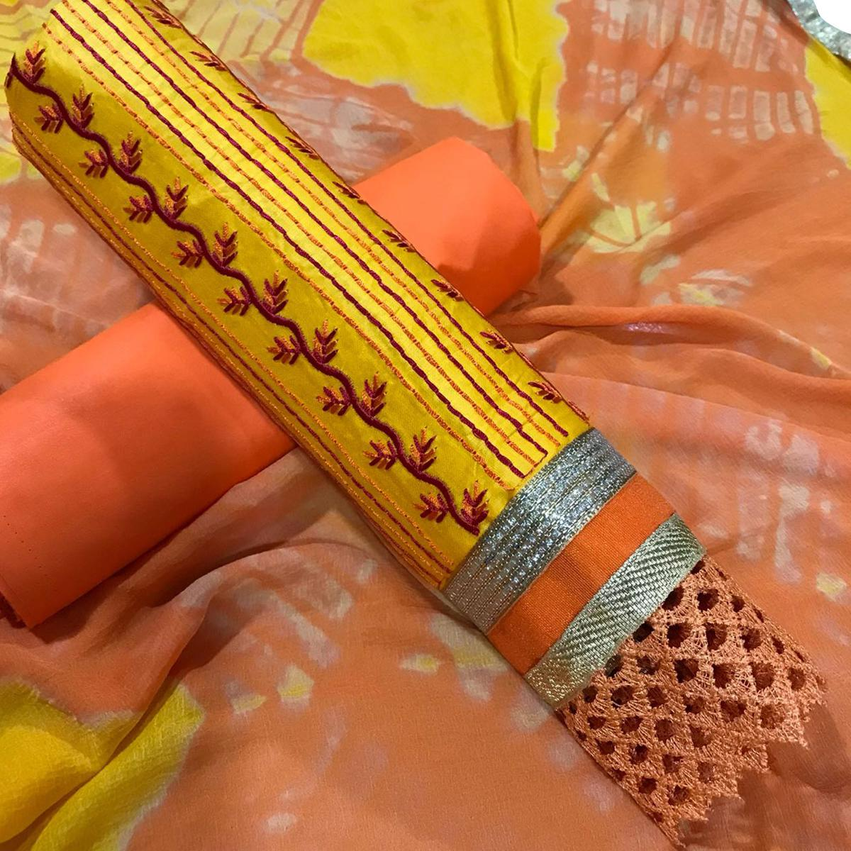 Gleaming Yellow-Orange Colored Partywear Embroidered Cotton Dress Material