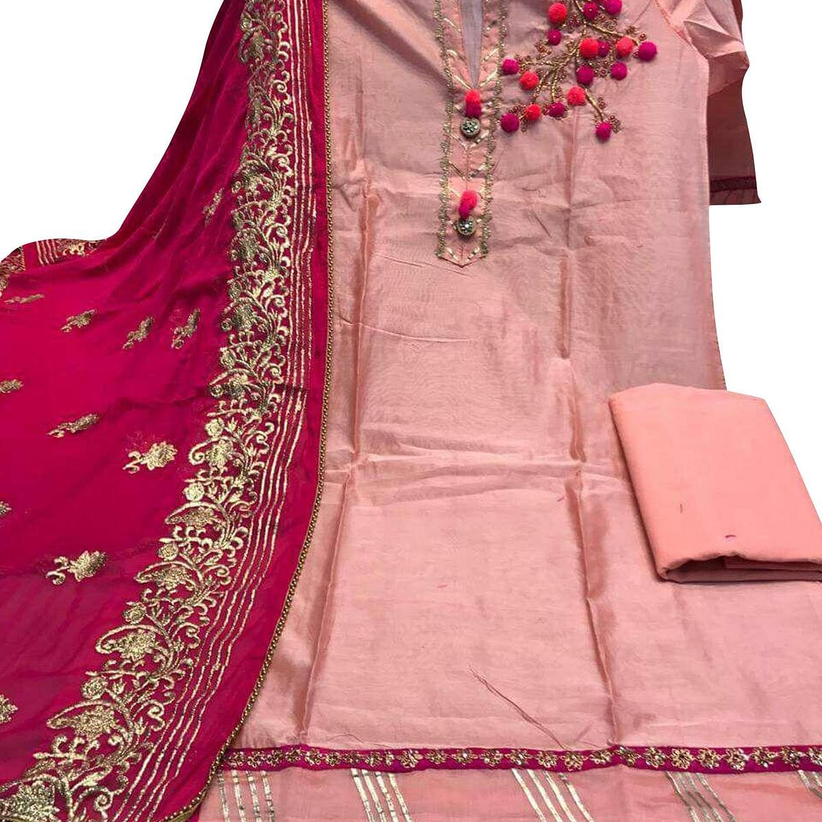 Hypnotic Peach Colored Partywear Embroidered Chanderi Silk Dress Material