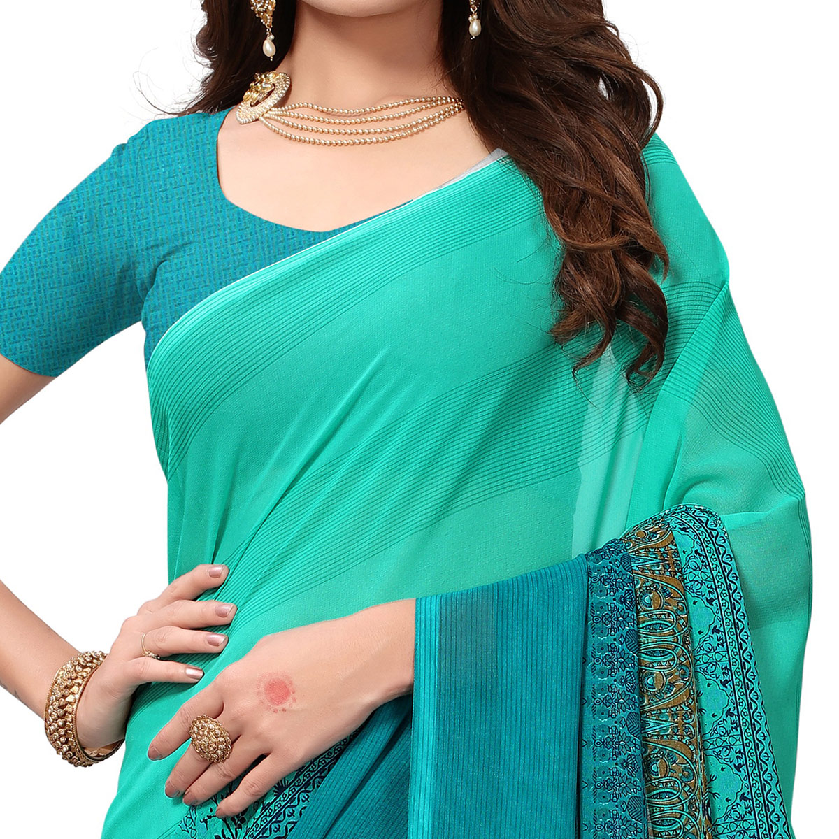 Lovely Turquoise Colored Casual Printed Georgette Saree