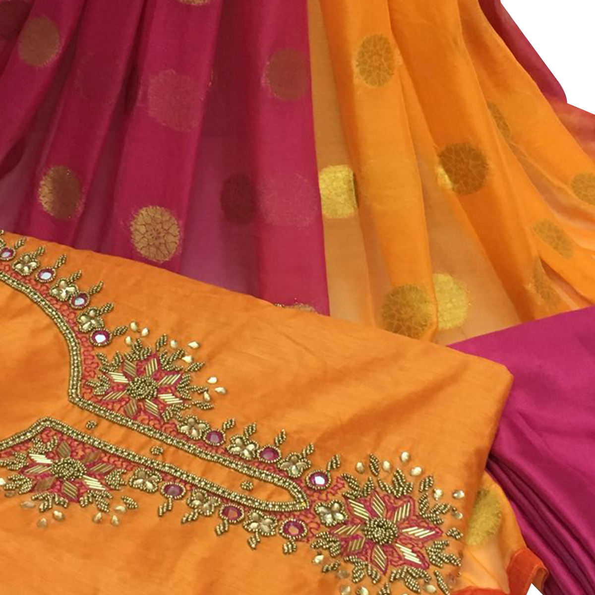 Gleaming Orange Colored Partywear Embroidered Santoon Dress Material