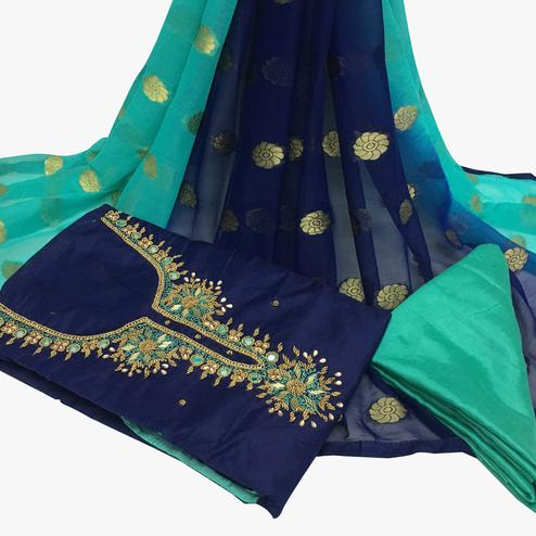 Surpassing Navy Blue Colored Partywear Embroidered Santoon Dress Material