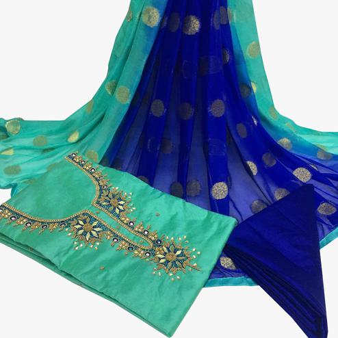 Excellent Turquoise Green Colored Partywear Embroidered Santoon Dress Material