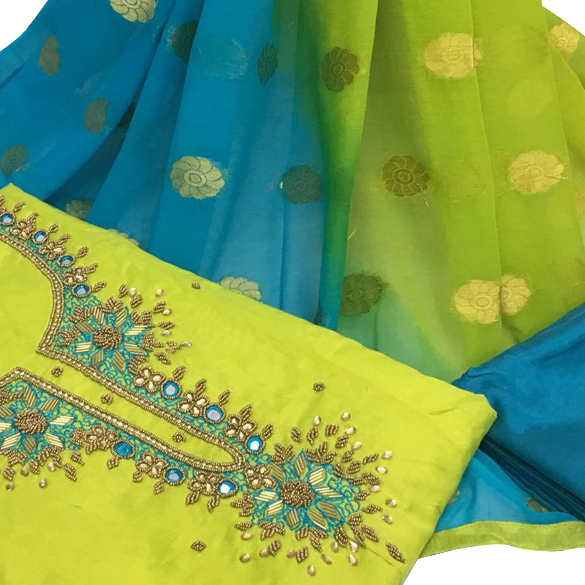 Beautiful Lemon Green Colored Partywear Embroidered Santoon Dress Material