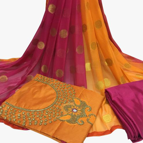 Magnetic Orange Colored Partywear Embroidered Santoon Dress Material