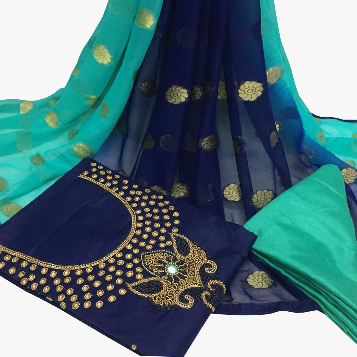 Majestic Navy Blue Colored Partywear Embroidered Santoon Dress Material