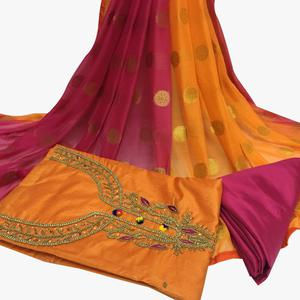 Arresting Orange Colored Partywear Embroidered Santoon Dress Material