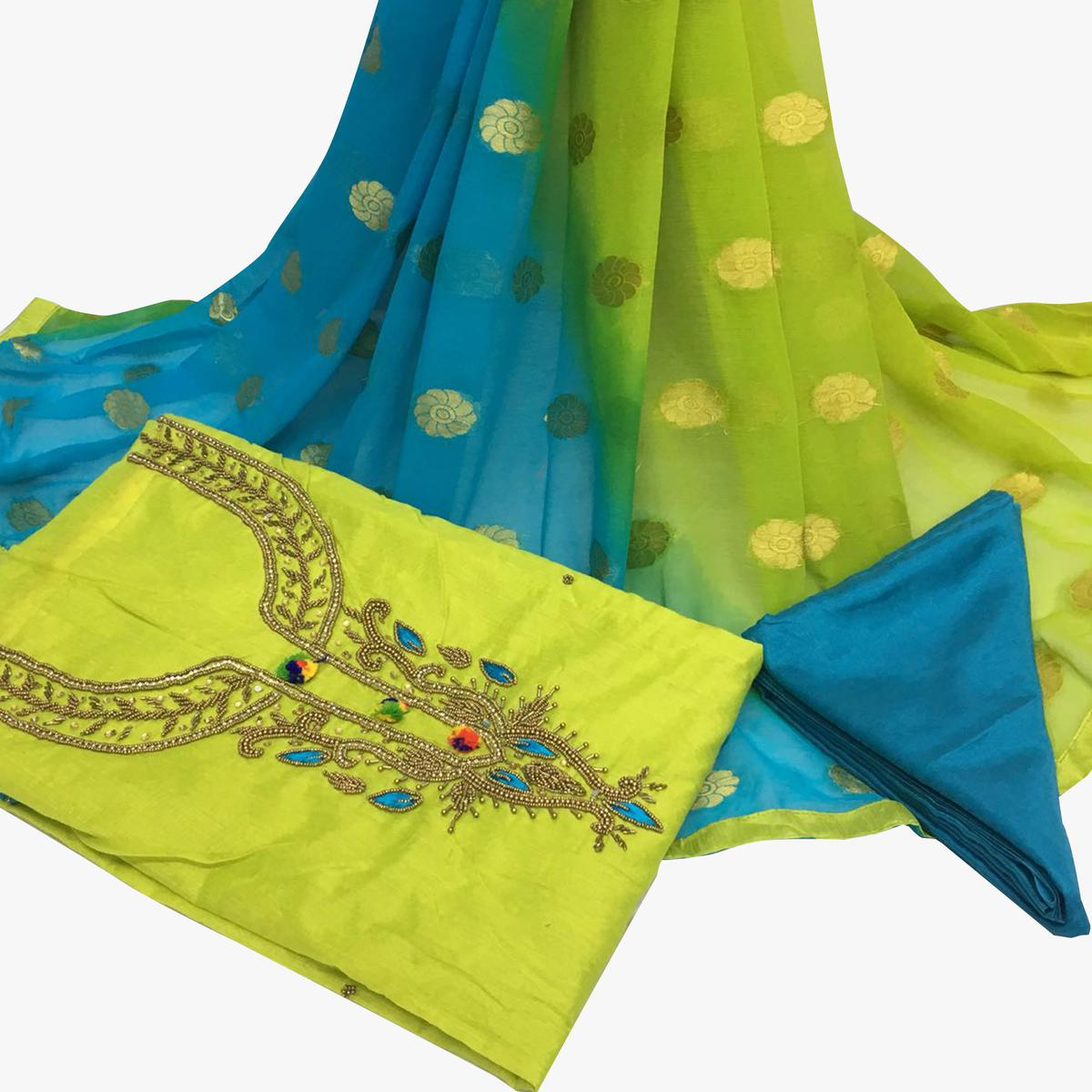Refreshing Green Colored Partywear Embroidered Santoon Dress Material